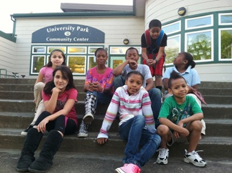 Children on the steps of University Park Community Center