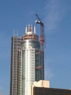 crane dangling from inner London building
