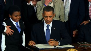 President Obama signs Obamacare law