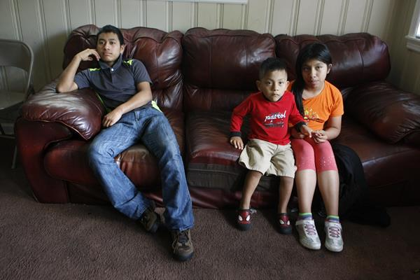 Melisa Jimon Reynoso, right, and her brother, Brian Jimon Reynoso, 3, center, sit with Candelario Jimon Alonzo, 16, left, at their home in Memphis, Tenn.