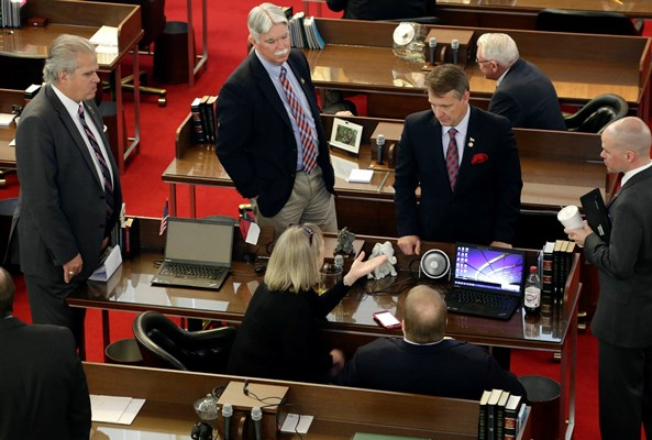 North Carolina lawmakers gather on the House floor