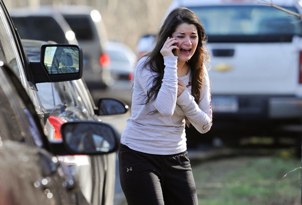 Carlee Soto uses a phone to get information about her sister, Victoria Soto