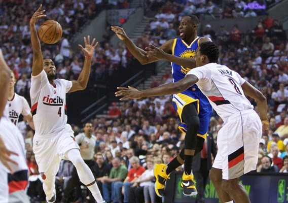 Portland Trail Blazers forward Maurice Harkless, left, steals the ball from Golden State Warriors forward Draymond Green, center, who was passing away from Trail Blazers forward Al-Farouq Aminu, right, during the first half of Game 3 of an NBA basketball second-round playoff series Saturday, May 7, 2016, in Portland, Ore. (AP Photo/Craig Mitchelldyer)
