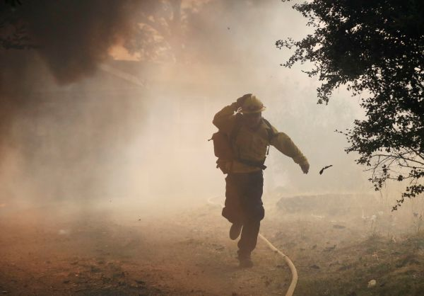 california wildfires fire fighter running
