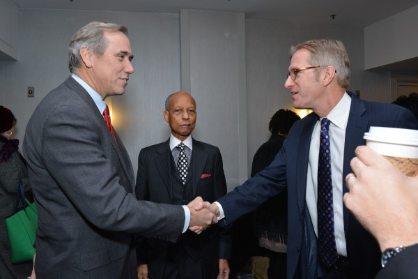 U.S. Senator Jeff Merkley of Oregon (left) shakes hands with Portland Mayor Ted Wheeler (right) at the 31st MLK Breakfast, Portland, Jan. 16, 2017 (Mike Norris)