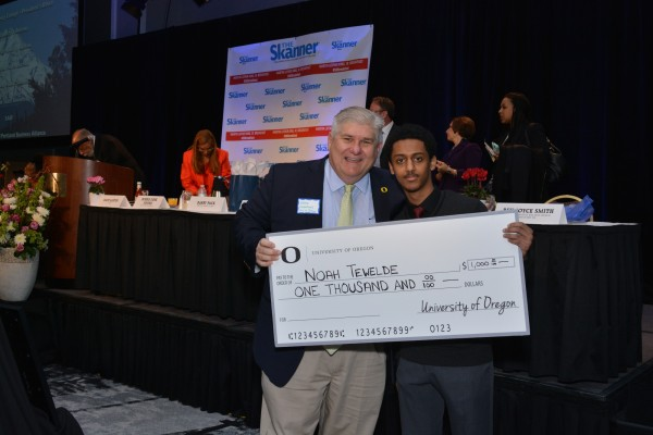 The Skanner Foundation Scholarship recipient, Noah Tewelde (right) with University of Oregon sponsor Roger Thompson (left) (Mike Norris)