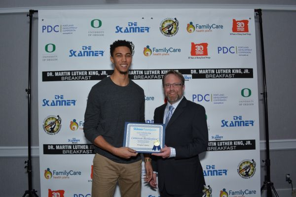 The Skanner Foundation Scholarship recipient, Cameron Retherford (left) with Oregon Lottery sponsor Barry Pack (right) (Mike Norris)