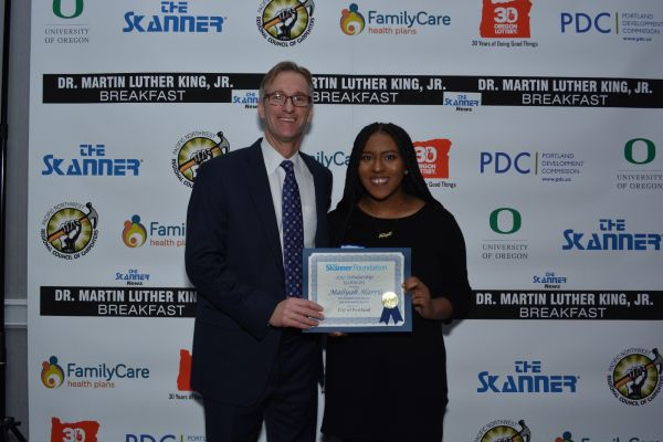 The Skanner Foundation Scholarship recipient, Maliyah Harris (right) with Portland Mayor Ted Wheeler (left) (Mike Norris)