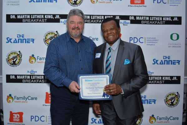Accepting on behalf of The Skanner Foundation Scholarship recipient, Anthony Sylvester, with Turner sponsor (Mike Norris)