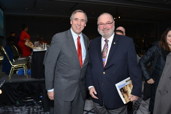 U.S. Senator Jeff Merkley (left) with guest at The Skanner's 31st MLK Breakfast, Portland, Jan. 16, 2017 (Mike Norris)
