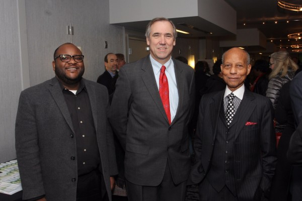 U.S. Senator Jeff Merkley of Oregon (center) with guest and The Skanner's Publisher Bernie Foster (right) at the 31st MLK Breakfast, Portland, Jan. 16, 2017 (Antonio Harris)