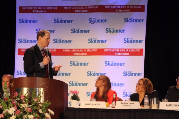 U.S. Senator Ron Wyden of Oregon (left) with emcee Daisy Santos (center) and The Skanner's Executive Editor Bobbie Dore Foster (right) (Antonio Harris)
