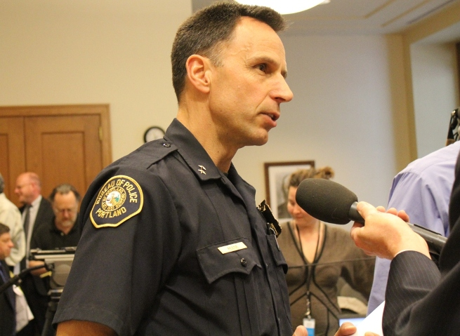 Portland Police Chief Mike Reese talks to a reporter
