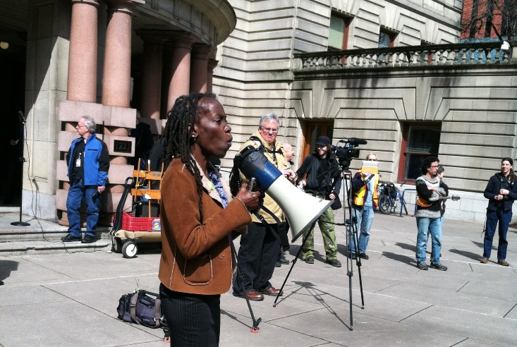 JoAnn Bowman speaking at a protest about Ron Frashour