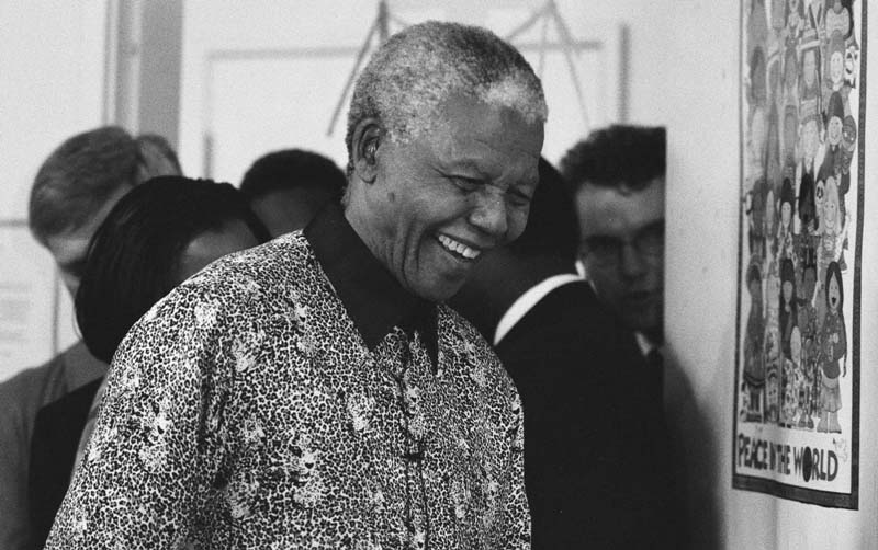 Nelson Mandela pictured smiling on a visit to Seattle