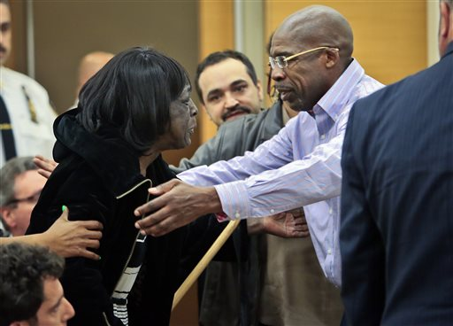 Jonathan Fleming reaches for his mother after being exonerated