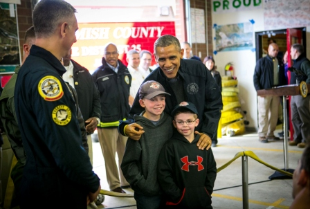 President Obama with rescuers and boys