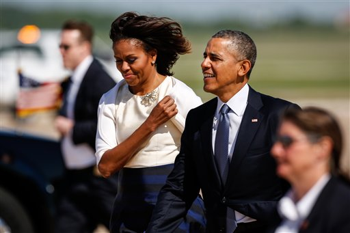 Barack and Michelle Obama arrive in Texas