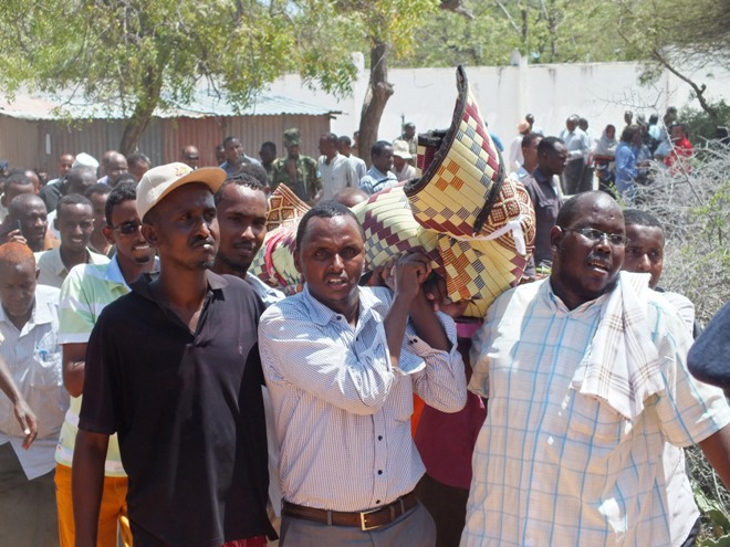 Mourners carry the body of a Somali lawmaker killed in Mogadishu Tuesday