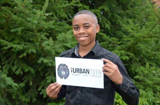 Zion Ward holding sign for iUrban Teen summit