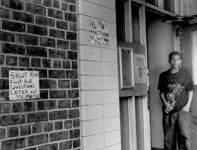 Ronald Herron stands in the doorway of the Gowanus Houses in New York