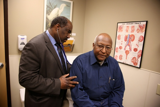 Dr. Willie Underwood examining patient Richard Waldrop