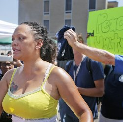 Woman protests Darren Wilson rally