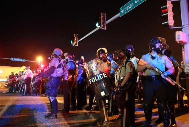 Police dressed in riot gear prepare for nightfall in Ferguson