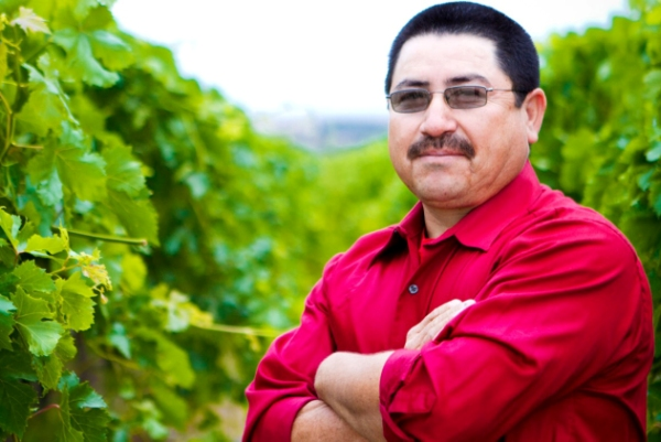 Raul Garcia standing in a grape vineyard in Bakersfield, Calif.