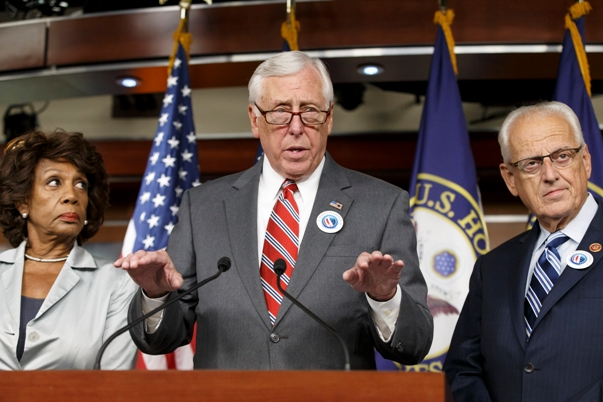 House Minority Whip Steny Hoyer of Md., joined by Rep. Maxine Waters, D-Calif., left, and Rep. Kerry Bentivolio, R-Mich., criticizes the efforts of Republicans