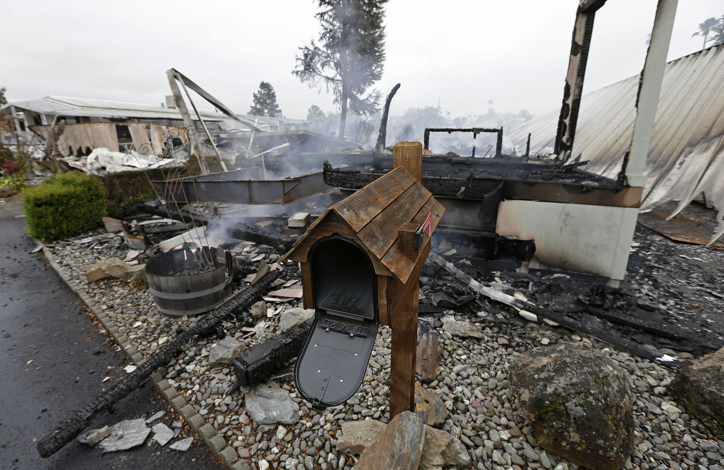 A mailbox from one of four mobile homes destroyed in a gas fire