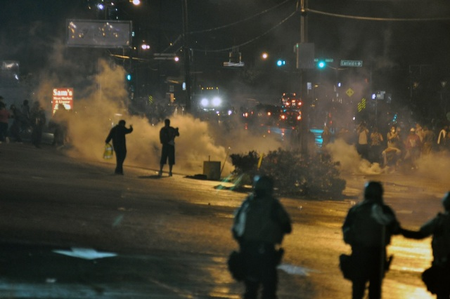 Policemen in Ferguson, Mo., using tear gas against protesters