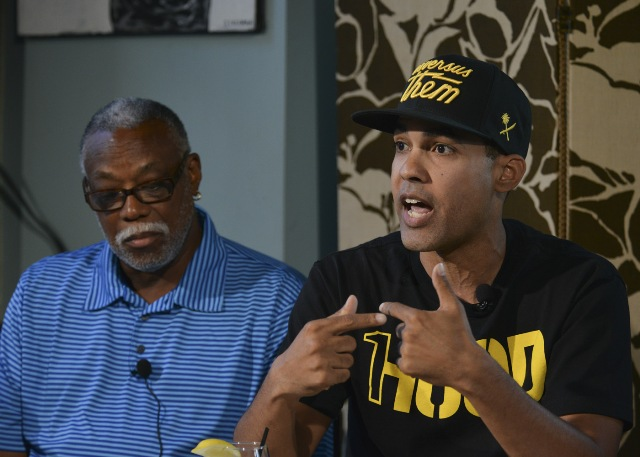 Hip hop artist and activist Jasiri X speaks during a town hall discussion on Michael Brown's death in Ferguson, Mo., and police brutality with Ron Hampton