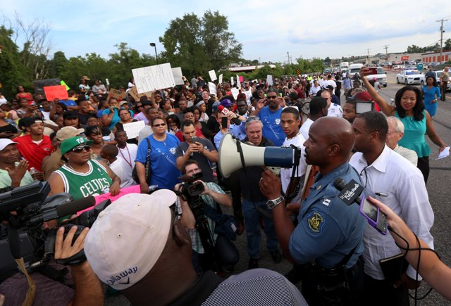 Missouri State Highway Patrol Capt. Ronald Johnson with protesters in Ferguson