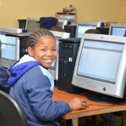 Child at a computer in classroom