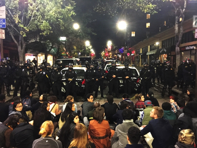 Berkeley police line up against demonstrators against Ferguson Mo