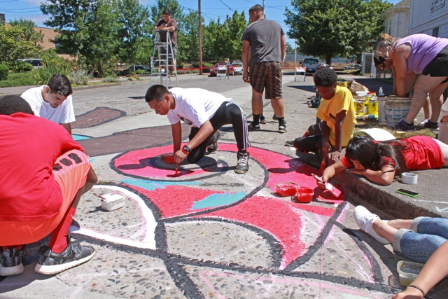 Teens paint a peace mural at North Borthwick and Killingsworth Court last July