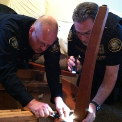 Chief O'Dea and assistant repair dining table