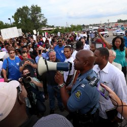 Missouri State Highway Patrol Capt. Ronald Johnson addresses protesters