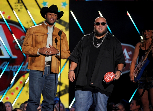 Big Smo Cowboy Troy present the award for album of the year at the American Country Awards