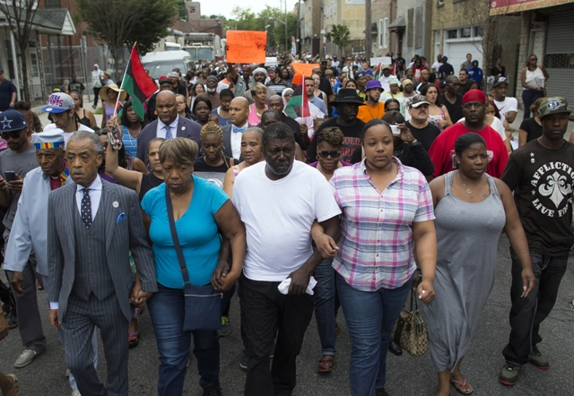 Al Sharpton and members of Eric Garners family march towards the site of his death