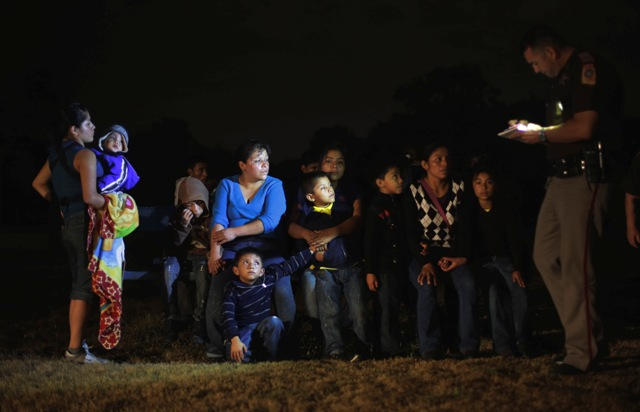 group of immigrants from Honduras and El Salvador who crossed the U.S.-Mexico border illegally are stopped,