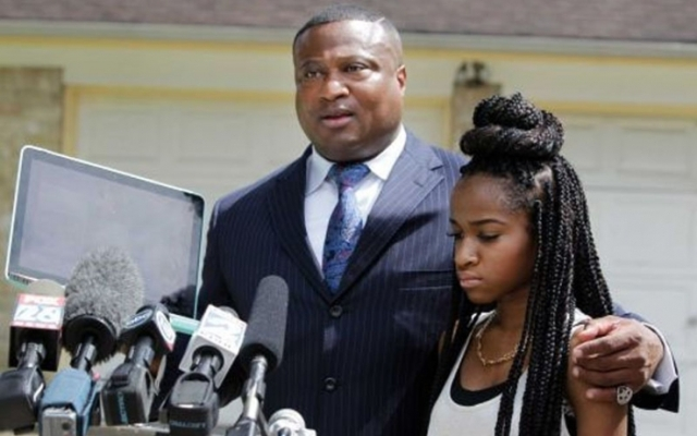 Quanell X and Jada speak at a press conference
