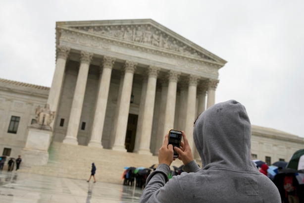 Tourist takes photo of Supreme Court building with phone