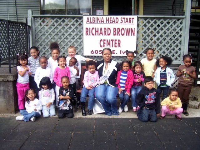 Former Miss Black Oregon Chelsea Deloney read books with Albina Head Start