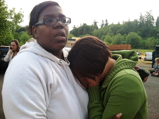 people hugging in the aftermath of the reynolds high school shooting