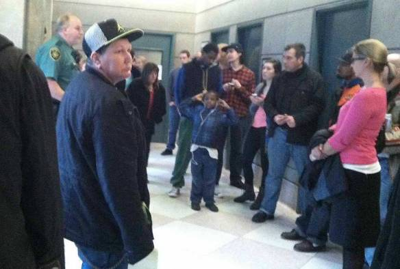 In the corridor outside courtroom
