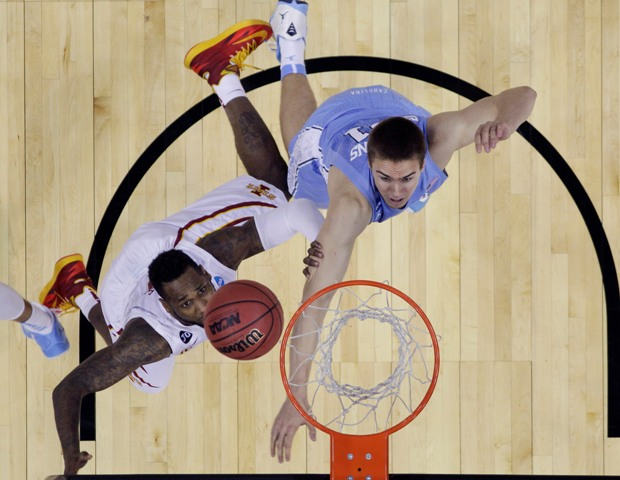Iowa State's DeAndre Kane, left, makes the winning shot over North Carolina's Jackson Simmons