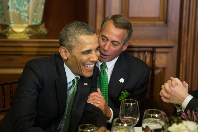 President Barack Obama shares a laugh with House Speaker John Boehner