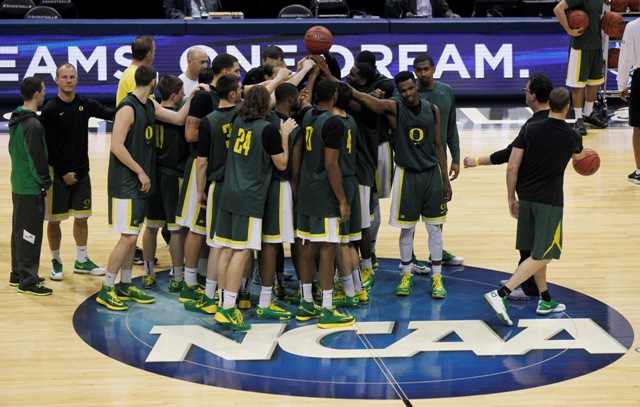 Oregon players huddle during a practice session for their NCAA college basketball tournament game